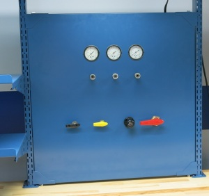 This custom gage panel attaches to an above work surface space manager.